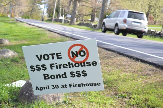 Opponents to the $17.5 million bond put up signs along Route 22 in Bedford.