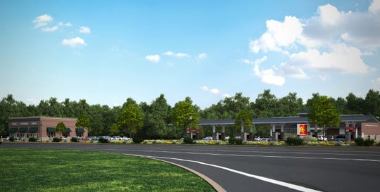 An artist rendering of the new Wawa and retail building on Wrangle Hill road.
