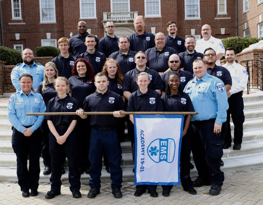 Local staff at the graduation ceremony of their intensive four-week EMS Academy training program.