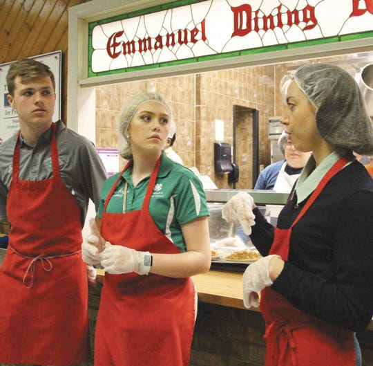 Aubrey Plaza (right) speaks with 4-H members ahead of Monday's lunch at the Ministry of Caring's Emmanuel Dining Room in Wilmington, Del.