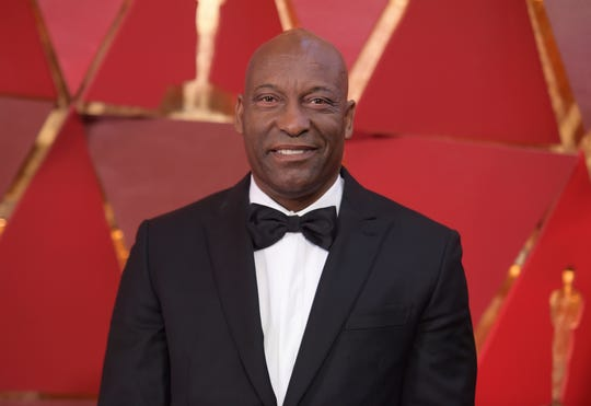 This March 4, 2018 file photo shows John Singleton at the Oscars in Los Angeles.