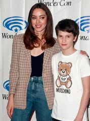 """Aubrey Plaza and actor Gabriel Bateman attend the """"Child's Play"""" press line during WonderCon 2019 at Anaheim Convention Center on March 30, 2019 in Anaheim, California. Plaza stars in the remake of the 1988 horror film, set to be released June 21."""
