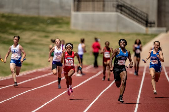 Lubbock Estacado leads the girls 4x100 relay Saturday at the Region I-4A Meet with Hirschi (left) placing second and Graham (right) in third.