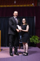 MSU Texas Provost Dr. James Johnston celebrates with Clark Scholar Amanda Renee Threlkeld, recognized at the 2019 honors banquet April 26, 2019.