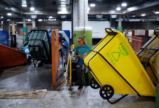 In this March 26, 2019, photo, people work in a recycling area in the back of the house at the Palazzo casino-resort in Las Vegas. The Venetian and Palazzo casino-resorts, which are operated by Las Vegas Sands, send their food scraps to the Las Vegas Livestock pig farm 25 miles north of the Strip.