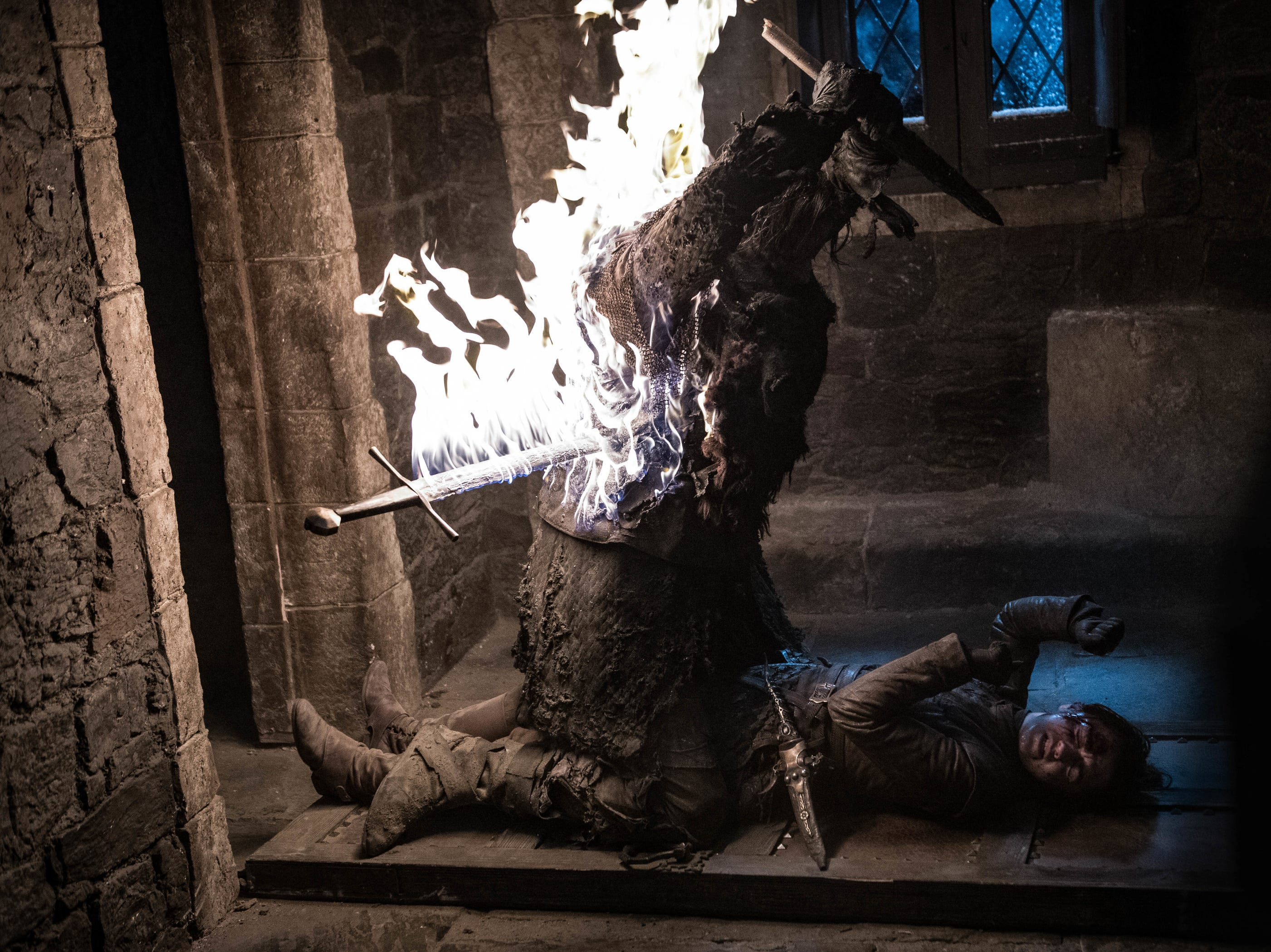 Arya Stark (Maisie Williams), below right, is spared death thanks to the fiery sword of Beric Dondarrion.