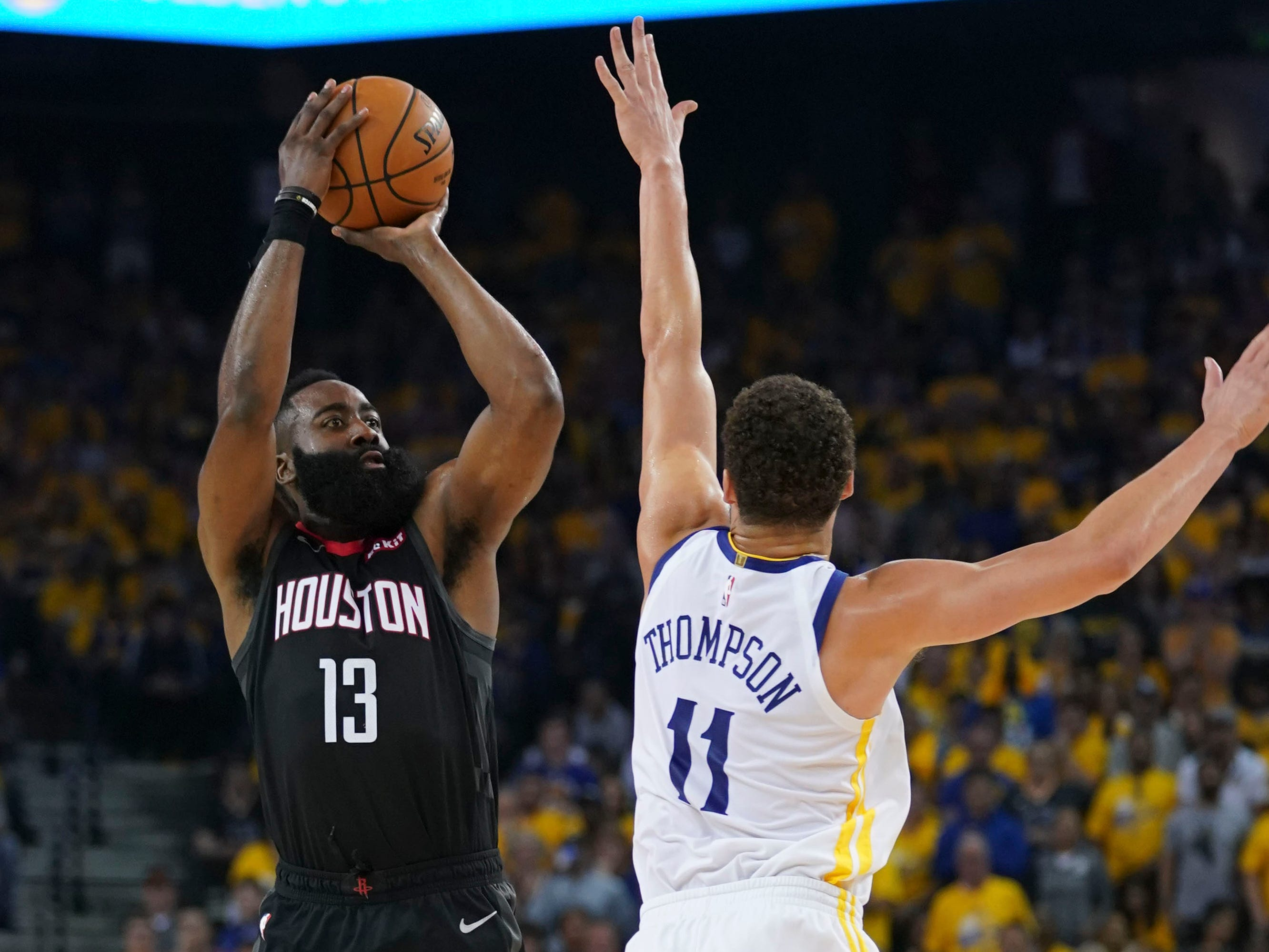 April 28: Rockets guard James Harden (13) shoots over Warriors defender Klay Thompson (11) during Game 1.