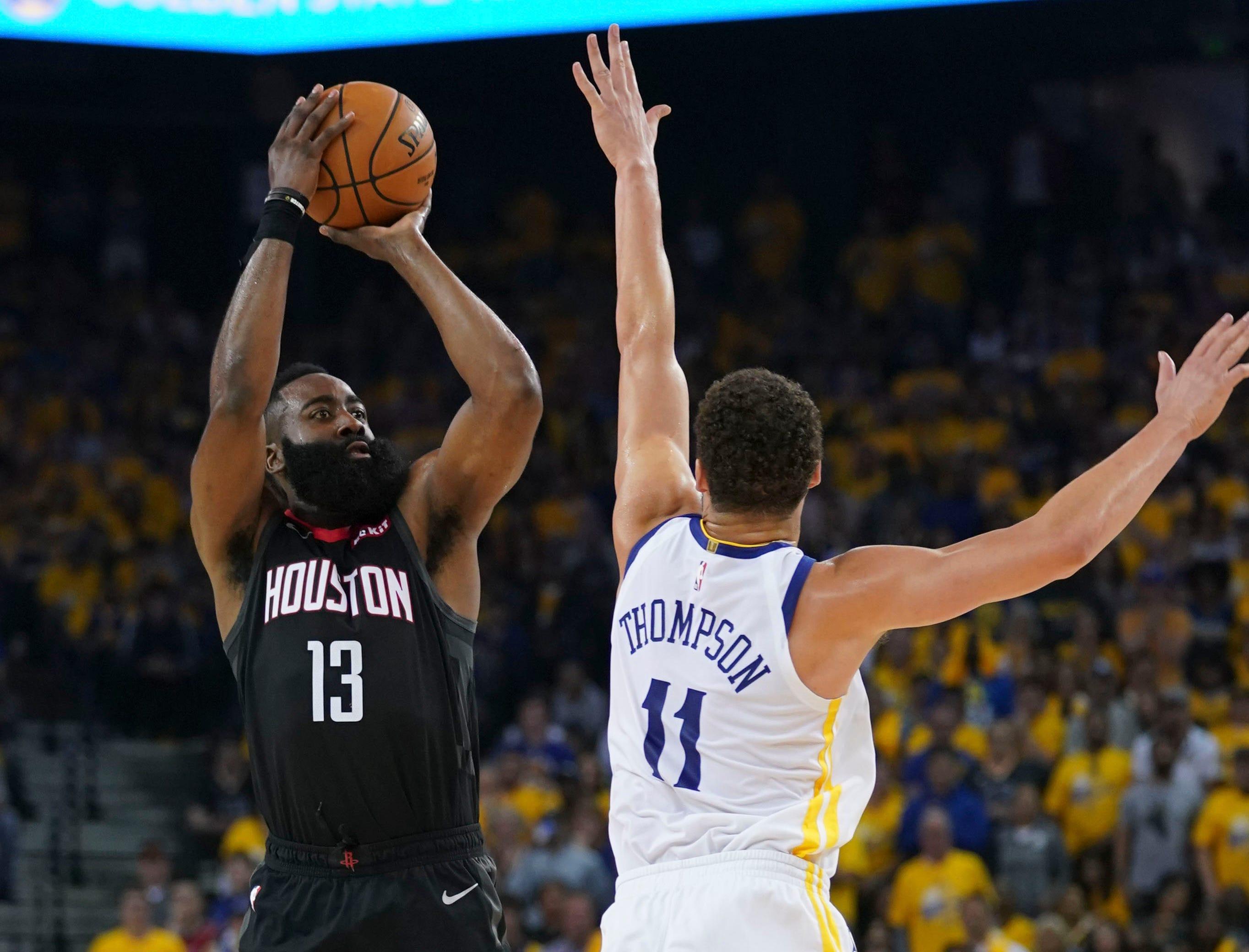 April 28: Rockets guard James Harden (13) shoots over Warriors defender Klay Thompson (11) during Game 1.