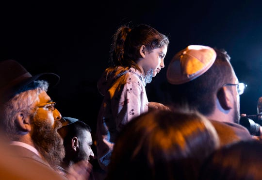 Eight-year-old Noya Dahan was injured in a Saturday synagogue shooting in Poway, California. She joined more than a thousand people from all religious beliefs at a vigil at Valle Verde Park in Poway Sunday night.