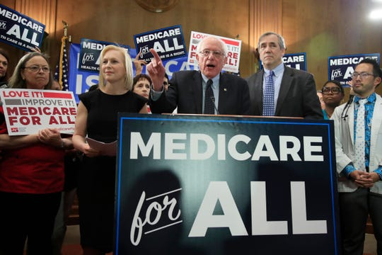 Sen. Bernie Sanders, flanked by Sens. Kirsten Gillibrand and Jeff Merkley, introduce the Medicare for All Act of 2019 in Washington on April 10, 2019.