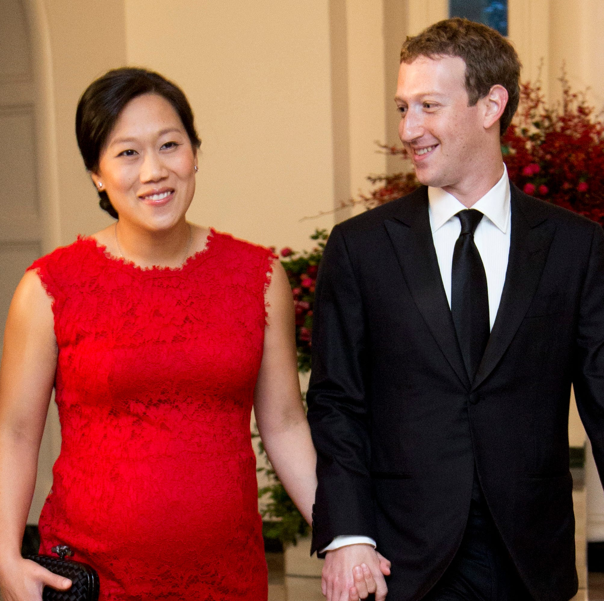 Facebook CEO Mark Zuckerberg and his wife Priscilla Chan, arrive for a State Dinner in honor of Chinese President Xi Jinping, in the East Room of the White House in Washington.