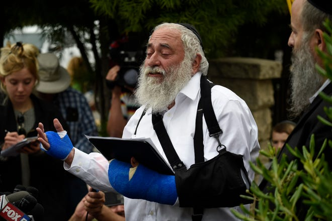 Rabbi Yisroel Goldstein is pictured during a press conference at the Chabad of Poway synagogue near San Diego on April 28. The rabbi, among the injured in an April 27 attack on the synagogue, watched a gunman fatally shoot Lori Gilbert-Kaye, who he said took bullets intended for him as he rushed to evacuate children, including his own granddaughter.