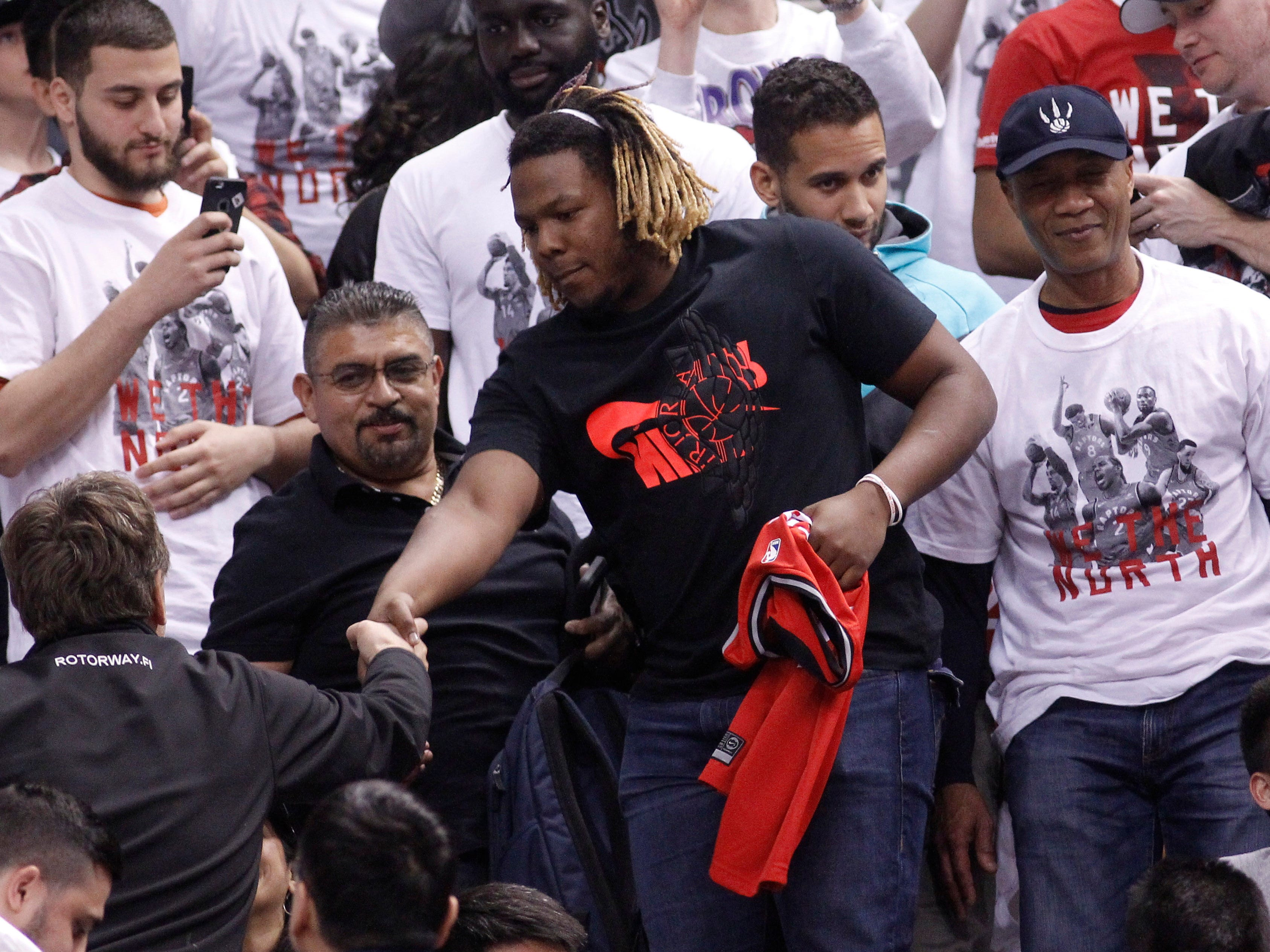 April 27: Toronto Blue Jays player Vladimir Guerrero Jr. greets fans during Game 1 between the Raptors and 76ers in Toronto.