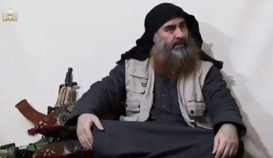 For the first time in five years, Islamic State group leader Abu Bakr al-Baghdadi appears in a video released by the group's propaganda arm. Image captured from video. April 29, 2019.