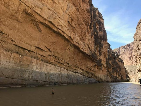 In Big Bend National Park, Thai-Son Elston walks across the Rio Grande to touch the Mexican rock cliff on spring break 2019.