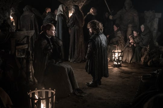 Sansa Stark (Sophie Turner), seated left, and Tyrion Lannister (Peter Dinklage) talk in the Winterfell crypt, awaiting the outcome of the battle above.