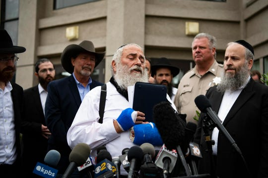 Rabbi Yisroel Goldstein speaks to reporters on Sunday in front of Chabad of Poway synagogue in California.