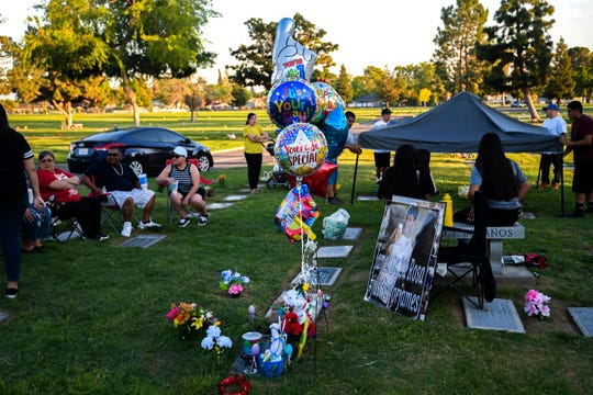 "Leticia de la Rosa and her family spend the evening at Greenlawn Cemetery to celebrate the birthday of James de la Rosa. ""Everyone I meet and I interact with is going to know that James was my son,"" said de la Rosa. ""He was amazing."" James de la Rosa would have turned 27."