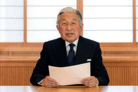 In this Aug. 7, 2016, file photo, provided by the Imperial Household Agency of Japan, Japan's Emperor Akihito reads a message for recording at the Imperial Palace in Tokyo. Akihito expressed concern about fulfilling his duties as he ages in an address to the public in a 10-minute recorded speech broadcast on national television that was remarkable for its rarity and its hinted possibility that he may want to abdicate in a few years. Akihito is ending his three-decade reign Tuesday, April 30, 2019 as he abdicates to his son, Crown Prince Naruhito, becoming the first to do so in 200 years, in a step nobody today has witnessed. (Imperial Household Agency of Japan via AP, File)