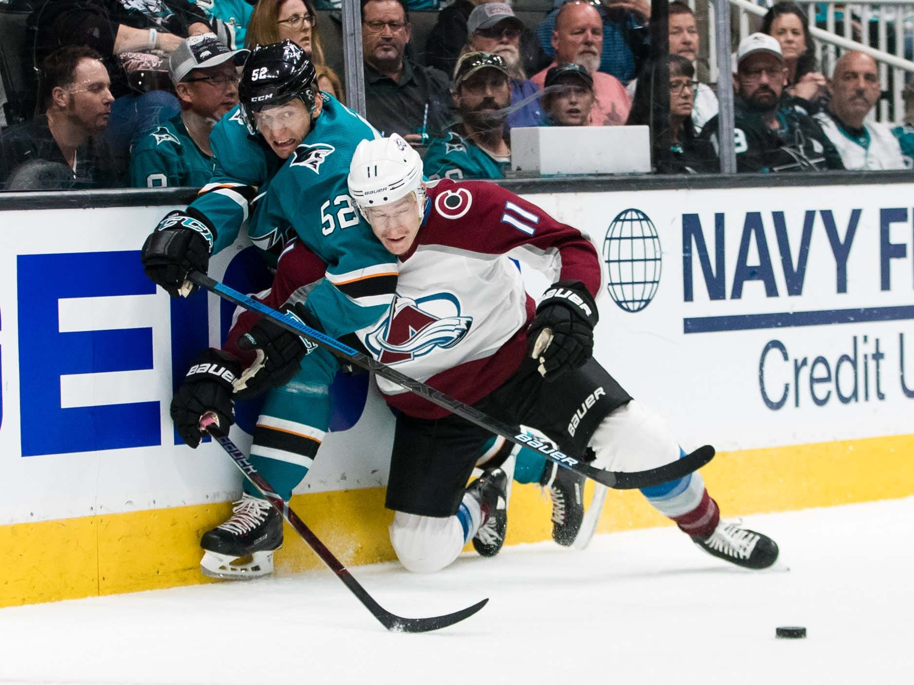 Second round: Avalanche LW Matt Calvert (11) collides with Sharks RW Kevin Labanc (62) during Game 2 in San Jose. Colorado won 4-3 to even the series at a game apiece.