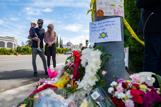 Troy & Katie Mckinney visit the memorial across the street from Chabad of Poway synagogue, April 28, 2019.