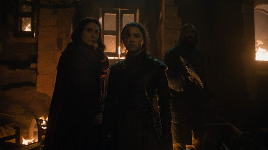Melisandre (Carice van Houten), left, Arya (Maisie Williams) and Sandor 'The Hound' Clegane (Rory McCann) consider the forces they are fighting in 'The Long Night.'