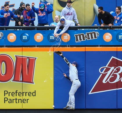 April 28:Milwaukee Brewers left fielder Ryan Braun has beer spilled on him as  a fan in the stands tries to catch the ball in the first inning against the New York Mets at Citi Field. The Mets won the game, 5-2.