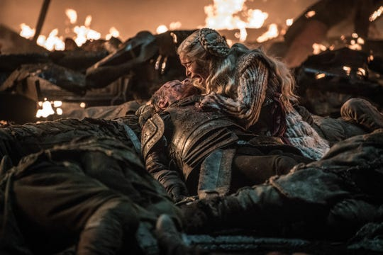 Daenerys Targaryen (Emilia Clarke), right, mourns over her fallen protector, Jorah Mormont (Iain Glen) in 'The Long Night' episode of 'Game of Thrones.'