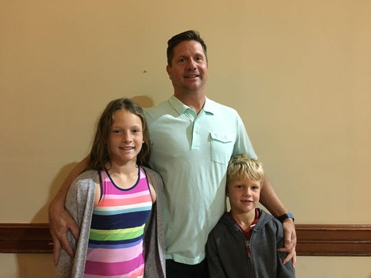 Larry Olson brought his daughter Brennan, 11, and son Trey, 6, to listen to O'Rourke, and also gave them some incentives.