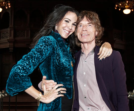 Mick Jagger with L'Wren Scott after her Fall 2012 collection was modeled during Fashion Week, in New York on Feb. 16, 2012.