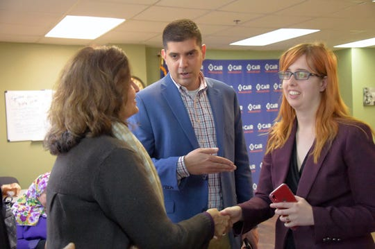 Saqib Ali introduces CAIR attorney Carolyn Homar, right, to his mother Samina Ali, following at a press conference, Wednesday, Jan. 9, 2019, in Catonsville, Md., announcing a legal challenge to Maryland's anti-BDS Executive Order.