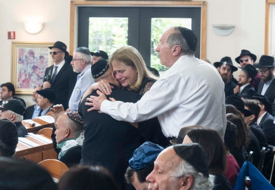 Hundreds of people came to pay their respects to Lori Gilbert Kaye, who was killed at Saturday's attack at the Chabad of Poway synagogue.