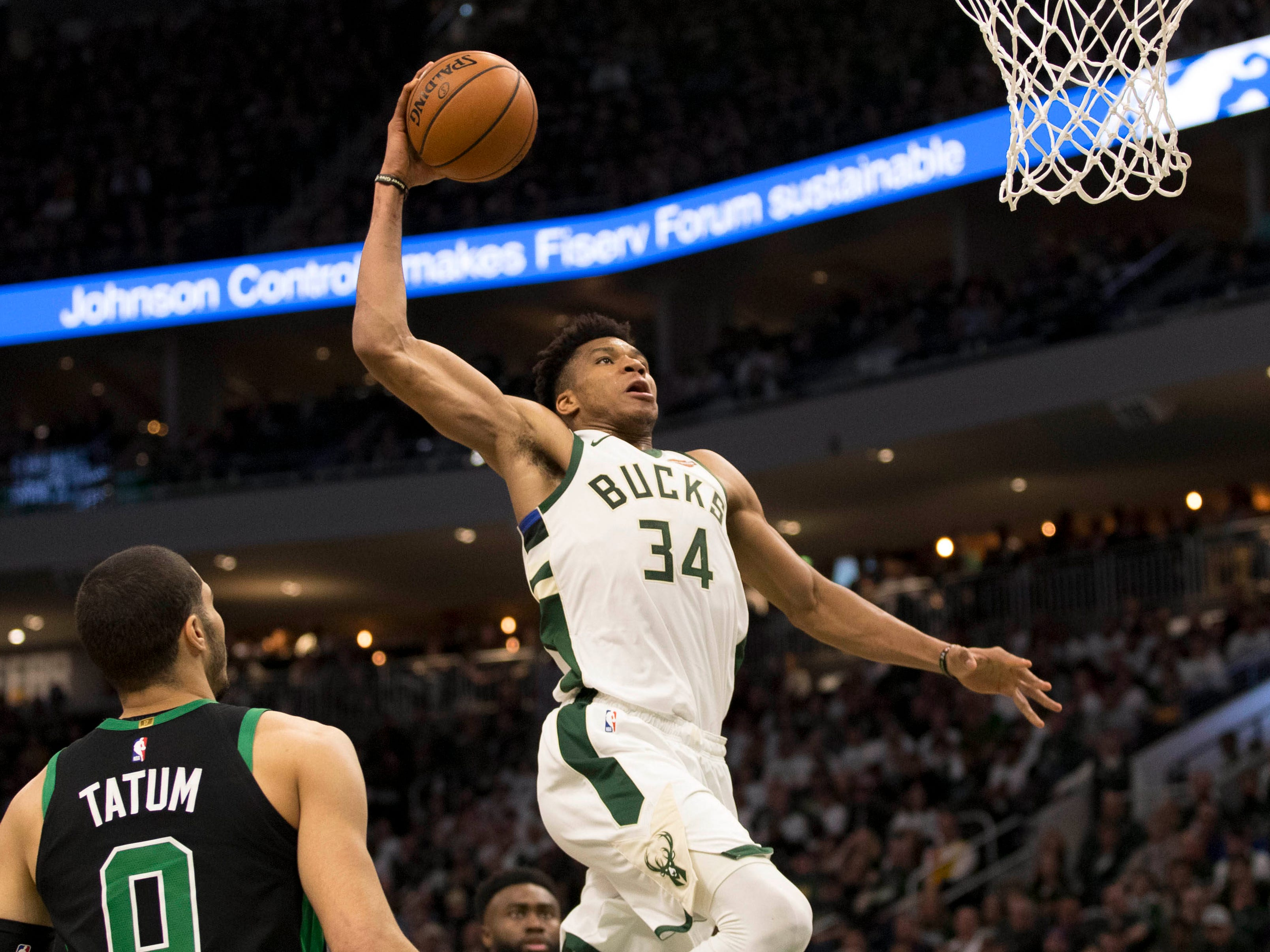 April 28: Bucks forward Giannis Antetokounmpo rises up for the one-handed slam during Game 1 against hte Celtics.