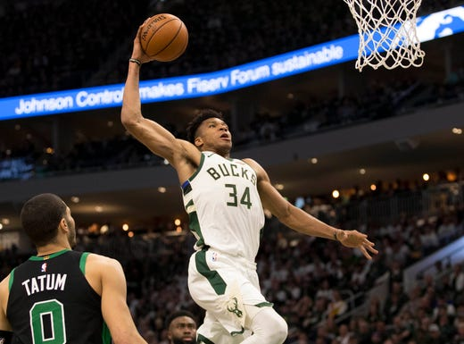 April 28: Bucks forward Giannis Antetokounmpo rises up for the one-handed slam during Game 1 against hte Celtics.