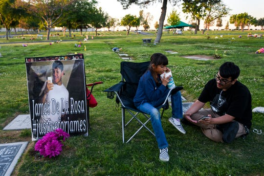 Leticia de la Rosa and her family spend the evening at Greenlawn Cemetery to celebrate the birthday of James de la Rosa.
