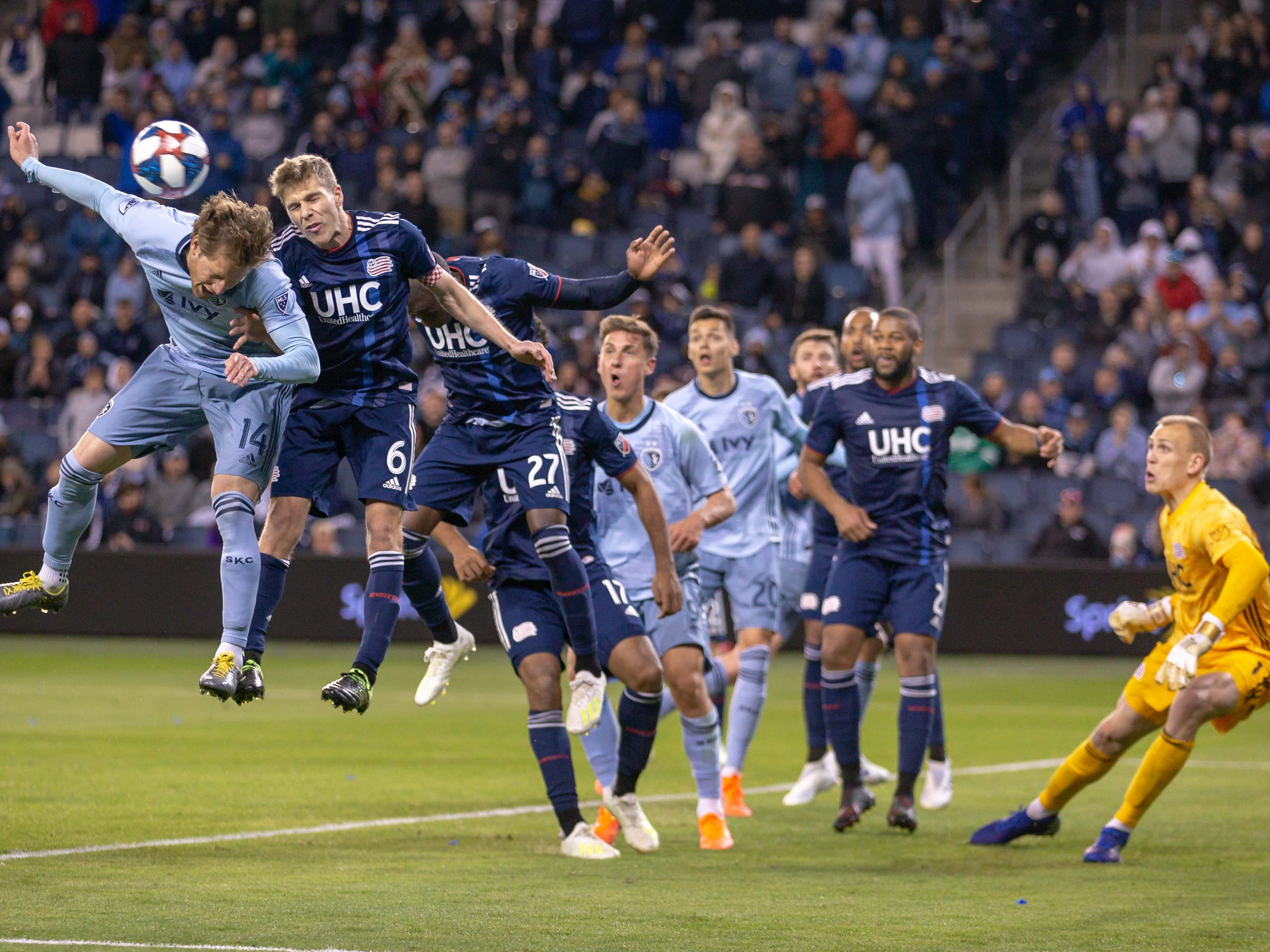 April 27: Sporting Kansas City and New England Revolution players go up for a header after a corner kick during the second half at Childrens Mercy Park. The game ended in a 4-4 tie.
