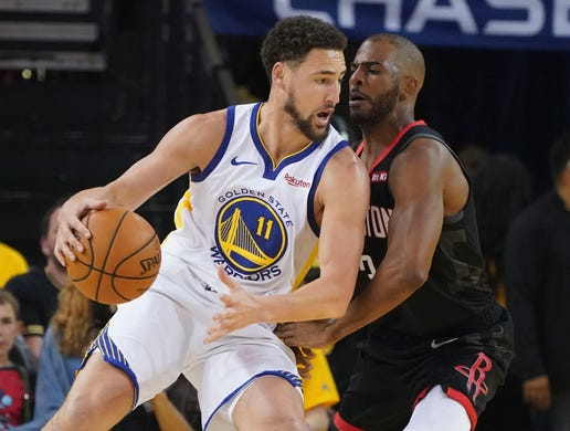 April 28: Warriors guard Klay Thompson (11) tries to back down Rockets defender Chris Paul (3) during Game 1 in Oakland.