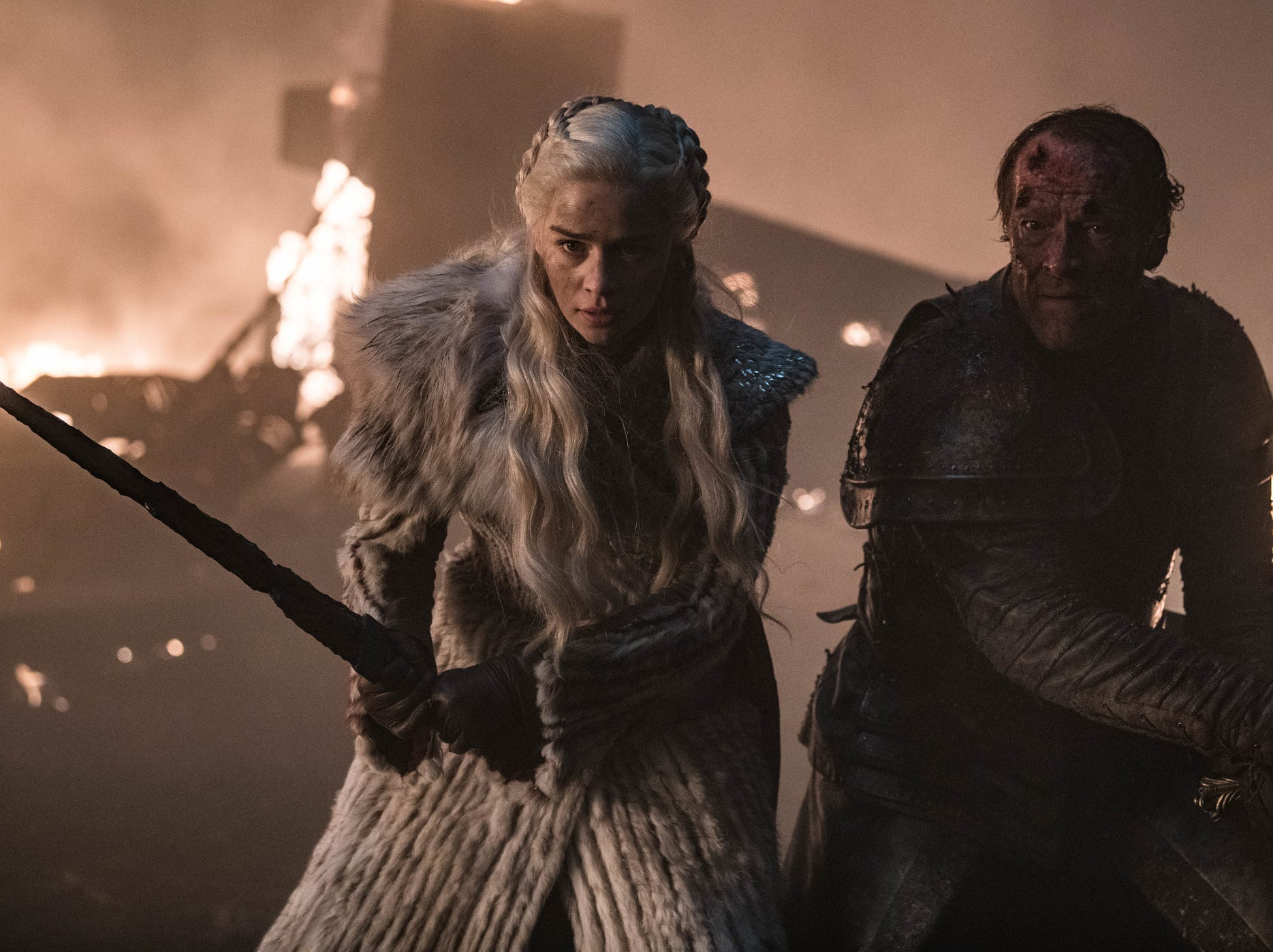 Daenerys Targaryen (Emilia Clarke), left, and Jorah Mormont (Iain Glen) try to fend off the Night King's forces on Sunday's 'Game of Thrones.'
