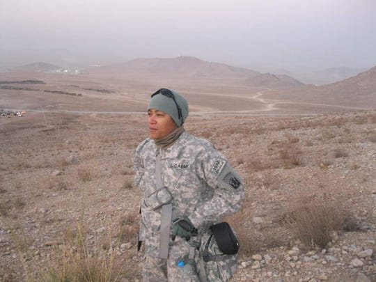 Then-Maj. Katrina Lloyd looks into the distance during her deployment to Iraq in 2010. Lloyd is the second African-American woman in the Louisiana National Guard to be promoted to the rank of colonel