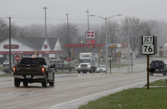 Traffic moves through the intersection of State 15 and State 76 in Greenville. Local leaders in favor of incorporation say the town already looks and acts like a village.