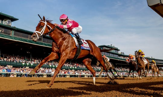 Vekoma, with Javier Castellano aboard, wins the Toyota Blue Grass Stakes at Keeneland on April 6.