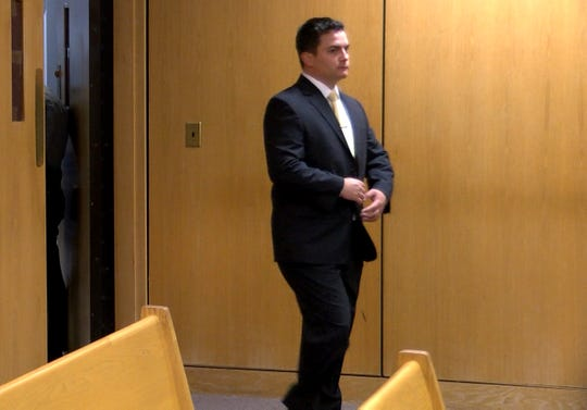 Justin Cherry, the Tuckerton police corporal charged with misconduct for siccing his police dog on a motorist, enters Superior Court in Toms River Tuesday, April 30, 2019.