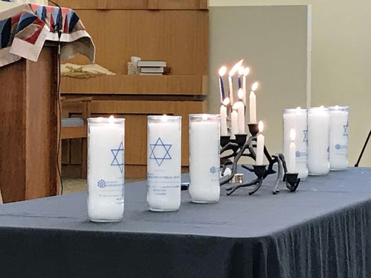 The six large candles each represented one million Jews killed in the Holocaust