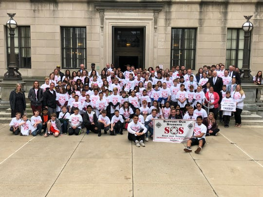 Toms River students, administrators and faculty went to Trenton April 30 to again ask for more state education funding. Here they are seen posing on the steps of the Statehouse.