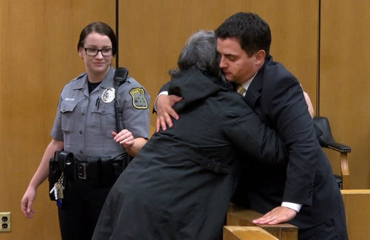 Justin Cherry, the Tuckerton police corporal charged with misconduct for siccing his police dog on a motorist, gets a hug after the morning session of his trial in State Superior Court in Toms River Tuesday, April 30, 2019.