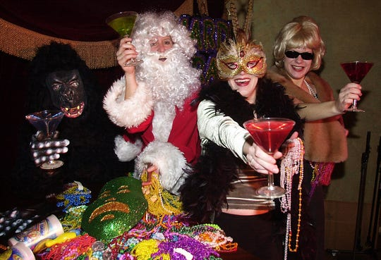 Tressa Thornton , Terri Abernathy, Beth Brown and Emily McLain dressed-up for Mardi Gras at Tressa's. in 2001
