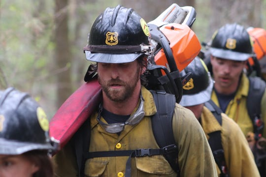 Members of the Asheville Interagency Hotshot Crew work on the Brushy Ridge Wildfire in Linville Gorge Wilderness April 29, 2019.