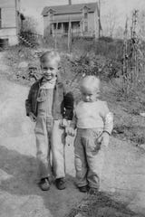 Max and Glenn Price pose in front of their home in Chicken Hill (also known as Factory Hill) in 1941.
