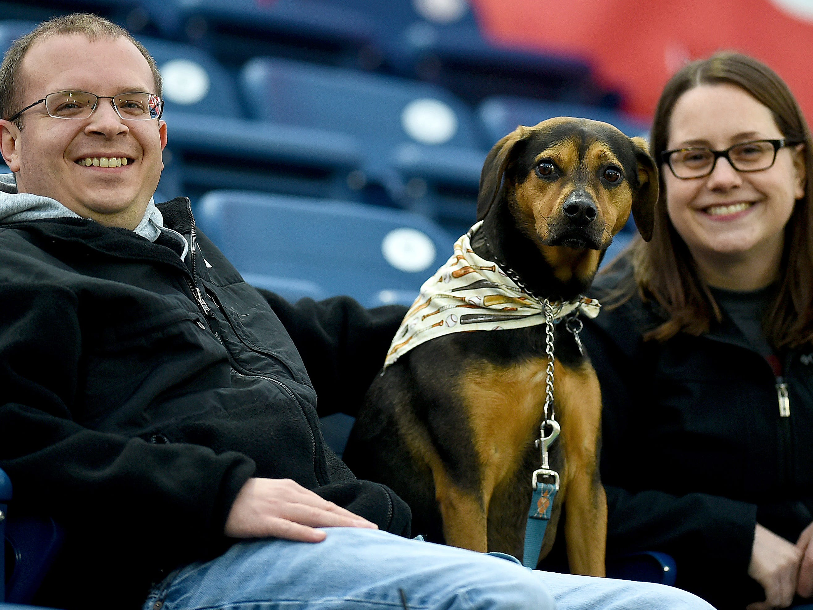 Nick and Megan Hagerbaumer of Binghamton with their dog Petey at Mutt Monday as the Binghamton Rumble Ponies take on the Akron RubberDucks at NYSEG Stadium, April 29, 2019.