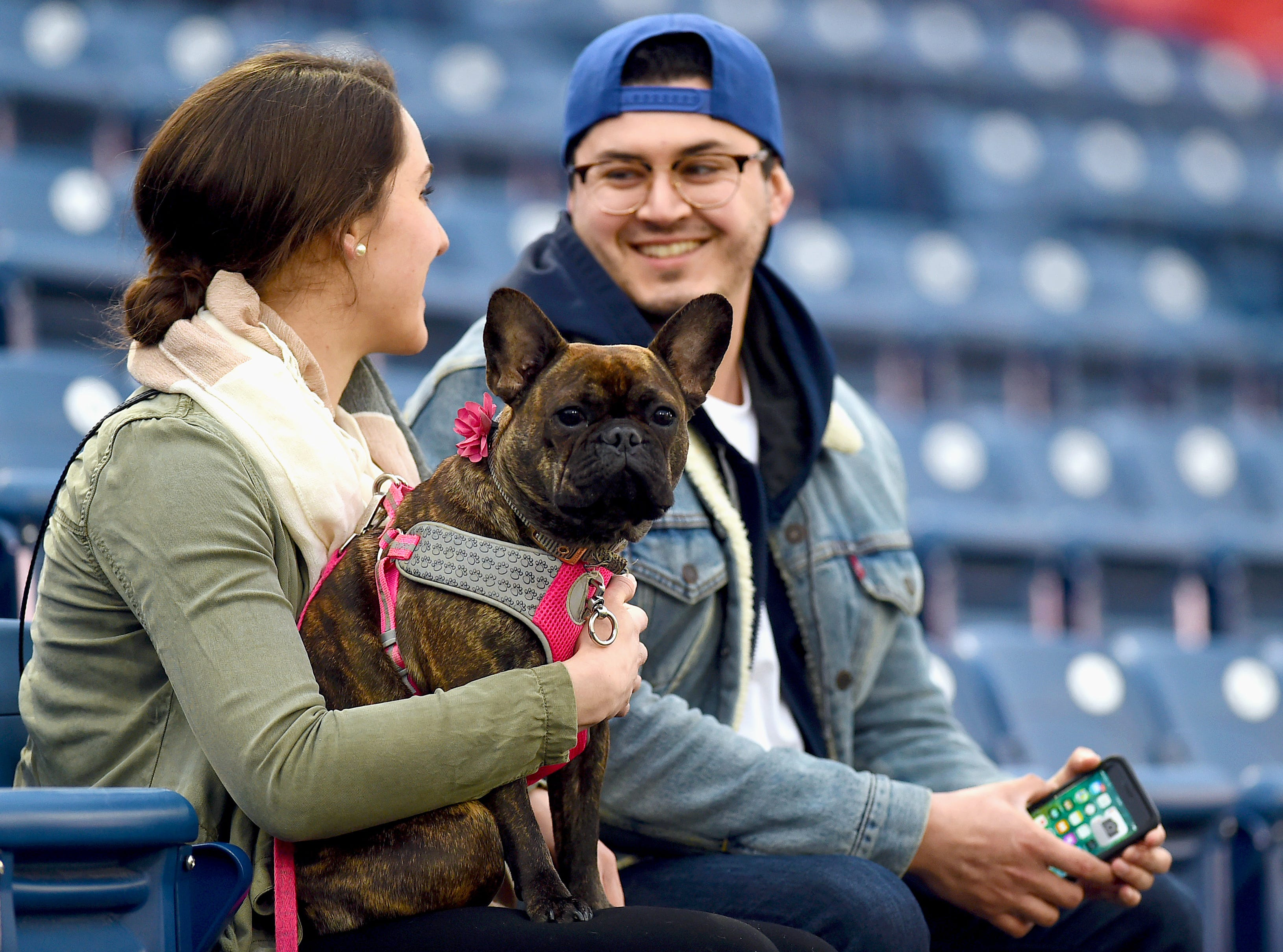 Penny and her owners Maura Reilly and Joe Curcuru of Binghamton during Mutt Monday as the Binghamton Rumble Ponies take on the Akron RubberDucks at NYSEG Stadium, April 29, 2019.